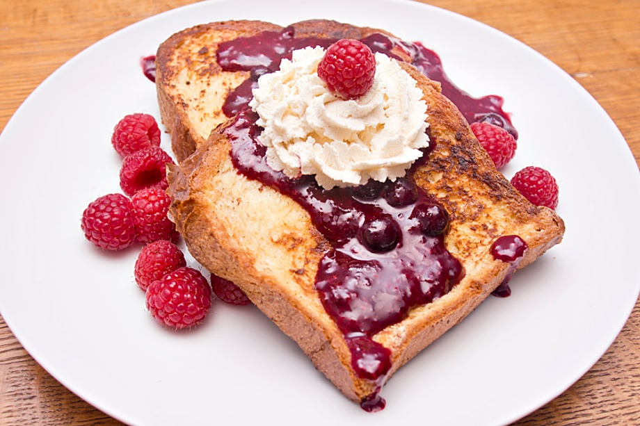 The French toast is topped off with our tart berry compote and Kahloa whipped cream