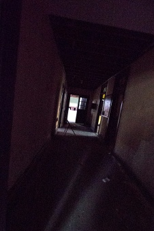 Dark Hallway with a Folding Chair